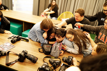 "Students with Down syndrome joke during a class at the Galera do Click or ""Click Crowd"" photography school in Sao Paulo"