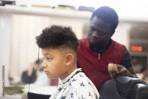 Boy In The African Barbershop Cute Mixed Boy Makes A