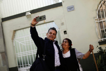 "A tourist takes a selfie with Margarita, a domestic employee in the house where ""Roma"" movie directed by Alfonso Cuaron was filmed, at Tepeji street in Roma neighborhood, in Mexico City"