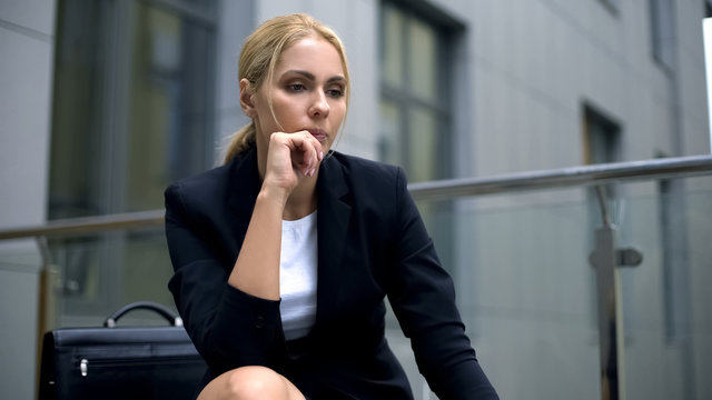 Upset business lady disappointed with lifestyle, desire to change job, uncertain