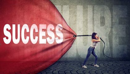 Motivated woman pulling a red banner with success word overcoming a failure
