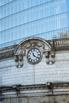 old railway clock on facade of building