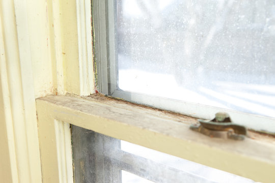 Old Wooden Window in Need of Replacement in Home