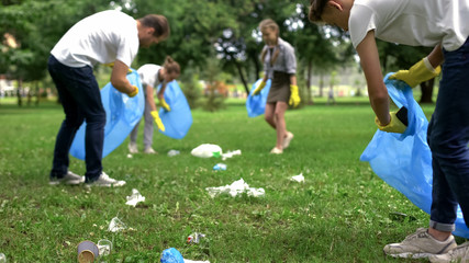 Friendly family organized cleaning day to clean park of household garbage Wall mural