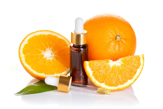 Orange essential oil isolated on white background. Orange oil for skin care, spa, wellness, massage, aromatherapy and natural medicine. Citrus oil