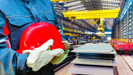 red protective helmet . Safety helmet . the worker in special clothes