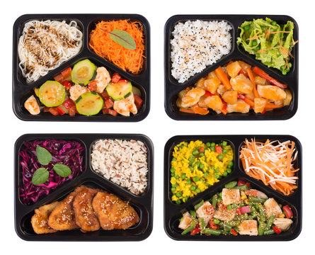 Set of containers with healthy cooked lunch isoalted on white background