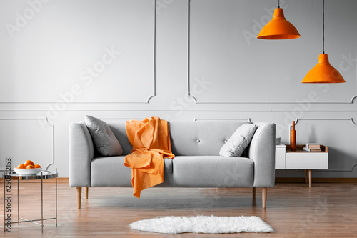 Orange Accents In Grey Living Room Interior With Copy Space On Empty