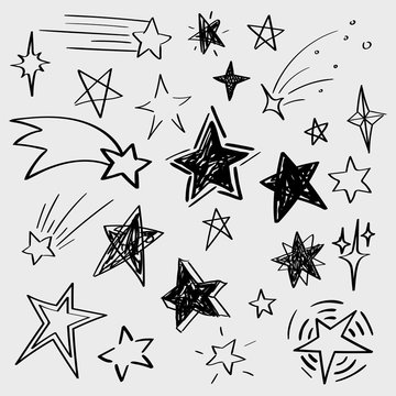 Set of black hand drawn vector stars in doodle style isolated on white background. Could be used as pattern element, cards, childish design
