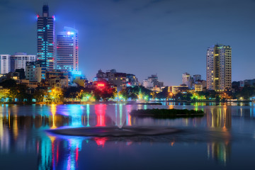 Hanoi Vietnam cityscape at night. City urban skyline of old town district