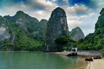 Wall Mural - Ha Long Bay Vietnam. Famous travel nature destination. Green mountains in the water. Islands landscape at Halong
