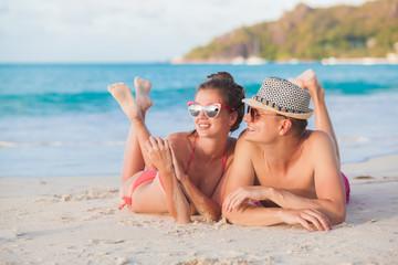 Couple on a tropical beach at Praslin island, Seychelles. Evening