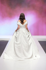 Bride walking away in a wedding dress