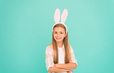 Child smiling play bunny role. Happy childhood. Traditions for kids to help get in easter spirit. Bunny ears accessory. Easter activities. Cute bunny. Holiday bunny girl posing with cute long ears