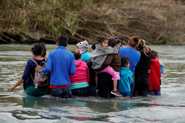 Migrants cross the Rio Bravo in Piedras Negras