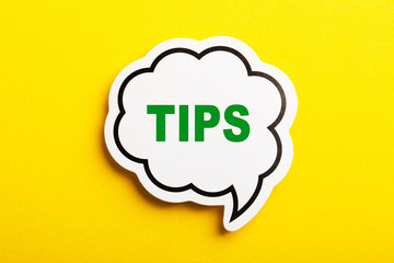 Tips Speech Bubble Isolated On Yellow Background