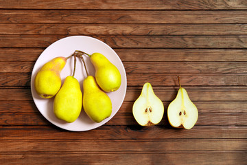Pear decoration stock images. Yellow pear on wood background. Pear home decor.