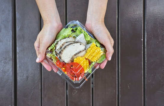 Healthy vegetarian salad in plastic package for take away or food delivery