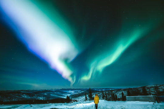 Girl watching Aurora borealis in Fairbanks, Alaska