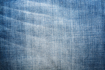 Shabby denim texture for background. Blue jeans