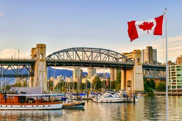 Ferry boat docked along in Granville island near Burrard Street Bridge at twilight in Vancouver,Canada Fototapete