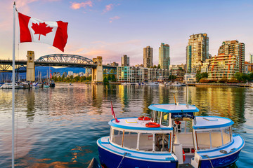 Ferry boat docked along in Granville island near Burrard Street Bridge at twilight in Vancouver,Canada Fotomurales