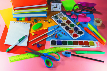stationery accessories - pens, markers, paints, scissors, stickers, notepads.