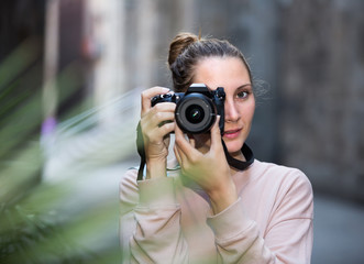 Portait of woman which is taking photos