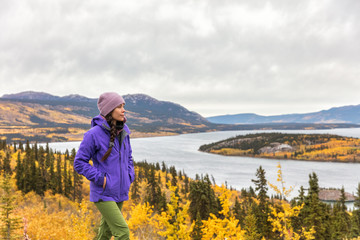 Hike nature outdoors Asian hiker woman relaxing walking happy in mountains of Alaska landscape background. USA travel in autumn.
