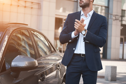 Young businessman near new car wating for meeting