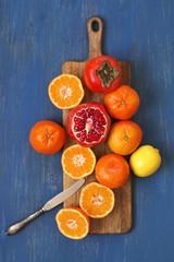 Mixed fruits on blue wood