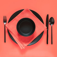 Coral colored and black table setting