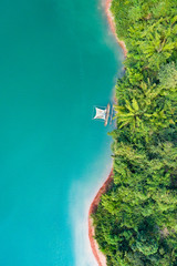 Printed roller blinds Island (View from above) Stunning aerial view of a a green coast of a tropical island with a traditional fishing boat in Nam Ngum Reservoir, Thalat, northern Laos.