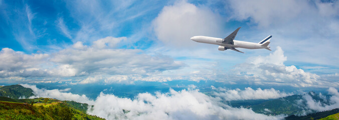 Printed kitchen splashbacks Airplane Panorama Photo An airplane flying in the blue sky. passenger plane flies highly over clouds of aerosphere. airplane flying in a clear pale blue sky. An airplane taking off at airport.