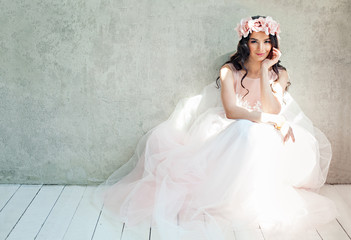 Beautiful bride woman in tulle roses wedding dress, lifestyle portrait