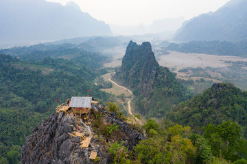 (View from above) Stunning aerial view of some tourists taking pictures at the beautiful panorama from the Nam Xay viewpoint in Vang Vieng, Laos.