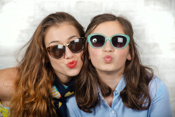 portrait of pretty beautiful charming adorable with long hair girl and her older friend