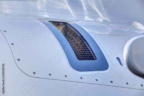 Small jet aircraft body panel with grating