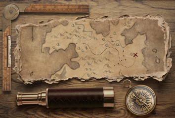 Wall Mural - Old torn treasure map with compass and spyglass top view still life. Adventure and travel concept. 3d illustration.