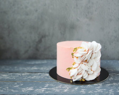 Pink wedding cake with wafer paper and gold decor