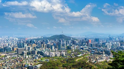 Fototapete - Time lapse of Cityscape in Seoul with Seoul tower and blue sky, South Korea.