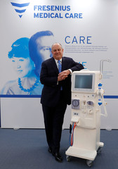 Rice Powell, CEO of Fresenius Medical Care, poses for a picture next to a dialysis machine made by Fresenius Medical care prior to the company's annual news conference at their head quarters in Bad Homburg