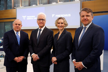 Powell, CEO of Fresenius Medical Care, Brosnan, CFO of Fresenius Medical Care, Empy, CFO of Fresenius and Sturm, CEO of Fresenius pose for a photograph prior to the company's annual news conference in Bad Homburg