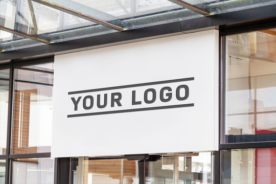 Outdoor sign on shop front window mockup