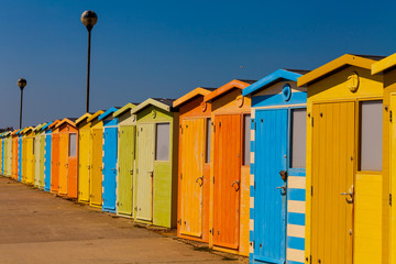 Wooden public change rooms on the beach. Colorful change rooms. Holiday concept