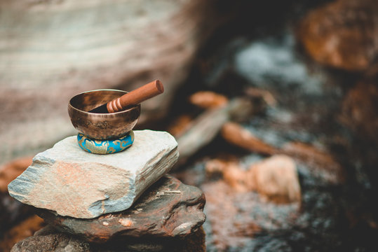singing bowl in a river