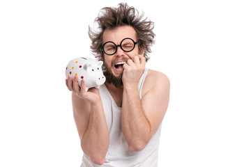 Crazy bearded Man with funny Haircut in eye Glasses holding Piggy Bank, isolated on white background. Saving Money concept. Male Screaming or Cry and about to break  piggybank.