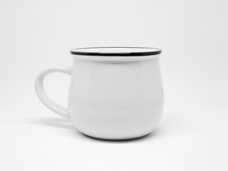 White enamel mug isolated on the white background mock up