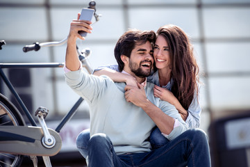 Smiling young couple in love taking selfie