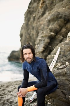 Portrait of a caucasian male surfer at the beach